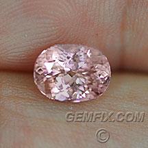 orange pink oval sapphire