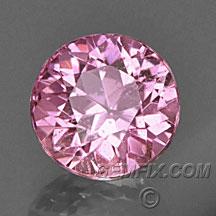 Round hot pink sapphire