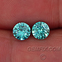 blue zircon round brilliant pair