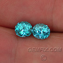 oval blue green zircon pair
